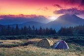 stock photo of wild adventure  - Tourist camp in a mountains - JPG