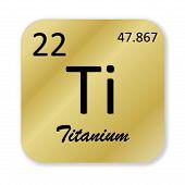 foto of titanium  - Black titanium element into golden square shape isolated in white background - JPG