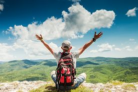 pic of mountain-high  - Man hiker greeting rich nature on the top of mountain - JPG