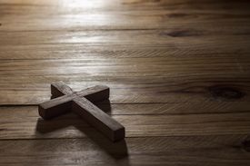 picture of holy-spirit  - Cross over wood table with window light - JPG