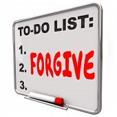 pic of forgiven  - Forgive word written on a to do list on dry erase board to illustrate the act of absolving - JPG