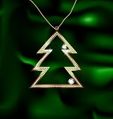 stock photo of adam eve  - on a green silk there is a jewel Christmas tree - JPG