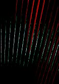 stock photo of accordion  - Accordion bellows. Extreme closeup of accordion bellows in red and black vertical image for background texture.