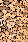 pic of firewood  - Dry chopped firewood logs in a pile  - JPG