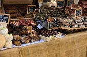 stock photo of charcuterie  - Various sausages on sale in a French market in Ajaccio Corsica France - JPG
