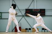 picture of rapier  - Little girl fencer and her trainer  - JPG