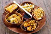 pic of chinese food  - a wood dish with different type of chinese food