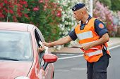stock photo of special forces  - Italian special military police force carabinier checking driving documents - JPG