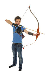 picture of longbow  - Boy with blue shirt and jeans aiming with a longbow isolated in white - JPG
