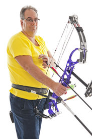 picture of longbow  - Man with yellow shirt and jeans standing with a longbow - JPG