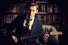 stock photo of rocking  - Handsome young man playing rock - JPG