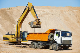 pic of boom-truck  - wheel loader excavator machine loading dumper truck at sand quarry - JPG