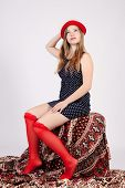 picture of garter  - young girl in a red hat and garters sitting - JPG