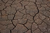 stock photo of drought  - Brown Drought land closeup pattern background texture - JPG