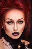 picture of gothic hair  - sexy woman with gothic makeup and red hair and castle - JPG