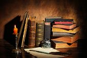 stock photo of inkpot  - Pile of the old books and a quill - JPG