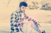 foto of hoodie  - young stylish bearded man in Hoodie checkered shirt listening music in the city instagram style - JPG