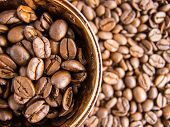 image of coffee crop  - Many coffee beans and coffee cup view from above - JPG