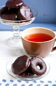 image of biscuits  - Homemade biscuits coated with chocolate and cup of tea - JPG