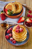 image of maple syrup  - Small pancakes with berries and maple syrup - JPG