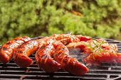 foto of grilled sausage  - Grilling sausages on barbecue grill - JPG