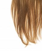 picture of strawberry blonde  - Straight hair fragment placed over the white background as a copyspace backdrop composition - JPG