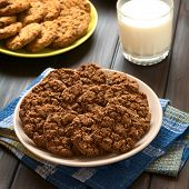 foto of cookie  - Chocolate oatmeal cookies on plate with a glass of milk and oatmeal - JPG
