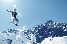 foto of snowboarding  - Snowboarder making jump high in clear sky - JPG