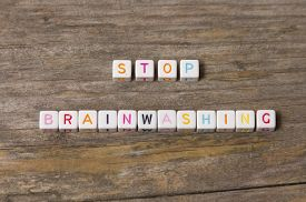 picture of brainwashing  - Stop brainwashing text on a wooden background - JPG