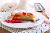 stock photo of sponge-cake  - Plum sponge cake with icing sugar on top - JPG
