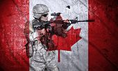 picture of rifle  - soldier holding rifle on a canada flag background double exposure - JPG