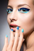 picture of nail-design  - Beautiful girl with bright creative fashion makeup and blue nail polish - JPG