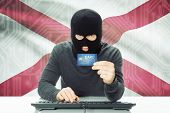 picture of alabama  - Hacker with US state flag on background  - JPG