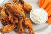 picture of chicken wings  - A dish of chicken hot wings and carrots with dipping sauce - JPG