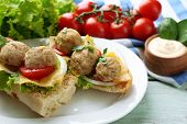 stock photo of meatball  - Meatball Sandwiches on wooden table background - JPG