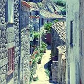 picture of stone house  - Old mountain village Monsanto(Portugal) with medieval narrow street and stone houses. Square toned image, instagram effect ** Note: Shallow depth of field - JPG