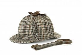 stock photo of investigation  - Sherlock Holmes Deerstalker Cap And Old Vintage Big Key Isolated On White Background - JPG
