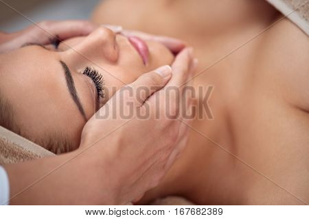 poster of Close-up of a young woman getting spa treatment at beauty salon. spa face massage. facial beauty tre
