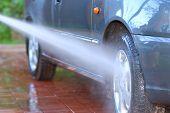 pic of car wash  - Car wheel washing shalow depth of field - JPG