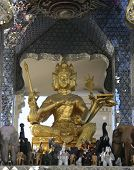 picture of siddhartha  - Buddha Statue with numerious elephant statues at its feet - JPG