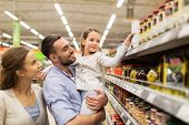 sale, shopping, consumerism and people concept - happy family with child buying food at grocery stor poster