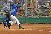 foto of baseball bat  - Young boy baseball batter about to swing the bat. All logos and trademarks have been removed from cleats catchers gear and baseball bat.