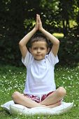 image of 6 year old  - 6 years old boy meditating outdoor - JPG