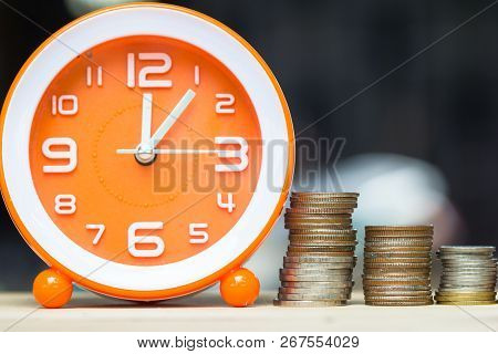 poster of Money Savings, Investment, Time And Money Growing Concept : Stacking Growing Coins, Moneybags And Or