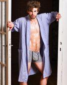 Man Confident Lover Near Door. Sexy Bachelor Lover Concept. Guy Attractive Lover Posing Seductive. S poster
