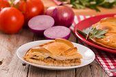 Spanish Tuna Pie With Onion On White Dish. poster