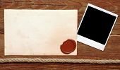 image of wax seal  - Old paper with a wax seal on a wood background - JPG