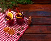 Christmas Hot Mulled Wine With Orange, Cinnamon Cardamom And Anise On Wooden Background. Hot Spicy B poster