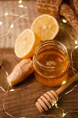 Composition With Honey, Lemon, Ginger Root As Natural Cold Remedies On Wooden Background, Winter Hol poster