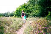 A Woman And Her Child Walk Along A Forest Trail. A Boy With A Backpack Travels With His Mother. Hike poster